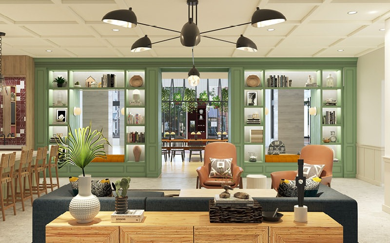 large, bright lounge area with kitchen and social spaces