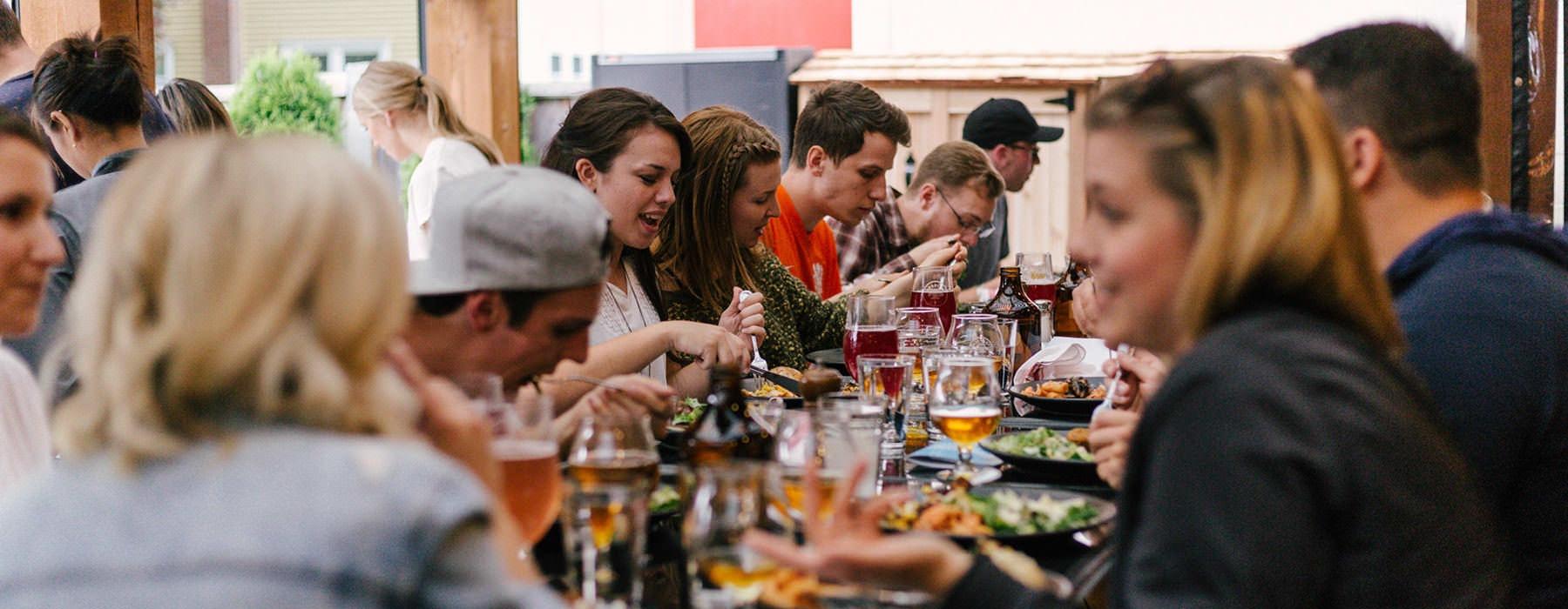 people talking and eating at neighborhood restaurant